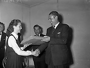 15/05/1959<br /> 05/15/1959<br /> 15 May 1959<br /> Gael Linn Competition at Listowel, Co. Kerry. Picture shows Eilin Ni Scanlain (14), 87 Church Street, Listowel, Co Kerry, 2nd prize winner receiving her prize from Dr. Sean Breathnach, Listowel. Included is Breandan O'Ciobhain, Radio Eireann (R.E.) singer.