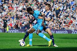 Emmanuel Adebayor (TOG) of Tottenham Hotspur is challenged by Gareth McAuley (NIR) of West Brom - Photo mandatory by-line: Rogan Thomson/JMP - 07966 386802 - 12/04/2014 - SPORT - FOOTBALL - The Hawthorns Stadium - West Bromwich Albion v Tottenham Hotspur - Barclays Premier League.