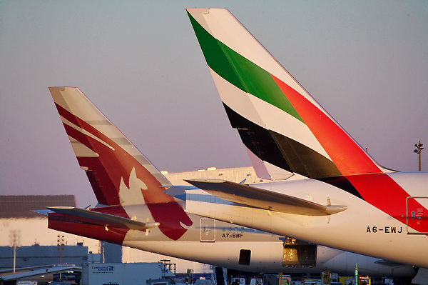 Tails of two commercial passenger jets at Houston's Intercontinental Airport