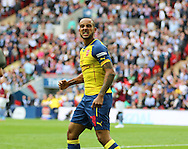 Arsenal's Theo Walcott celebrates the opening goal during the The FA Cup match between Arsenal and Aston Villa at Wembley Stadium, London, England on 30 May 2015. Photo by Phil Duncan.