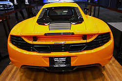 08 February 2012: 2012 MCLAREN MP4-12C: Known for impressive racing cars, McLaren has released their second-ever roadgoing automobile, the magnificent McLaren MP4-12C. Appearing at the 2012 Chicago Auto Show, the mid-engine, two passenger sports car creates 592 horsepower and 443 lb. ft. of torque from the 3.8-liter twin-turbo V8 engine. All that power is directed to the 20-inch rear wheels via a seven-speed automatic transmission. Weight-saving is an obsession at McLaren, starting with the compact downsized engine, which is combined with the new one-piece MonoCell cabon fiber composite chassis. The close position of the driver and passenger allows for a narrower, lighter body while giving improved visibility with a clearer perception of the car's extremities. Inside the cockpit, the airbags, steering column and a significant number of interior components all mount to a single one-piece pressure die cast magnesium beam that is 75 percent lighter than steel. With its low rate of weight to high horsepower/torque, the McLaren MP4-12C is capable of 0-60 mph in 3.2 seconds, and can reach 205 mph top speed, all for an MSRP of $229,000. Chicago Auto Show, Chicago Automobile Trade Association (CATA), McCormick Place, Chicago Illinois