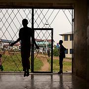 A red cross volunteer exercises at a local school in central Bujumbura, Burundi.