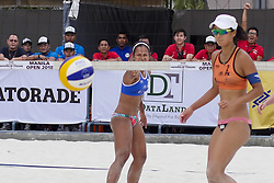 May 5, 2018 - Pasay, National Capital Region, Philippines - The first day of FIVB (Fédération Internationale de Volleyball) Beach Volleyball World Tour, Manila Open 2018, with its third day for women's quarter finals. Games are held on Sands SM by the Bay area of SM Mall of Asia...Its Philippines versus Japan for the quarter finals. Philippines team in blue top are (1) Cherry Ann Rondina and (2) Angeline Marie Gervacio. Japan team in orange top are (1) Shinako Tanaka and (2) Sakurako Fuji...Angeline Marie Gervacio points to the ball just after she scores. (Credit Image: © George Buid via ZUMA Wire)