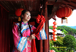August 26, 2017  An actress performs 'ball throwing', a traditional way to choose a husband, in Xidi Village of Yixian County, in Huangshan City of east China's Anhui Province, during traditional wedding conventions of Huizhou to greet the Qixi festival, or Chinese Valentine's Day. (Credit Image: © Shi Guangde/Xinhua via ZUMA Wire)