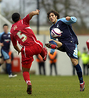 Photo: Matt Bright/Sportsbeat Images.<br /> Swindon Town v Swansea City. Coca Cola League 1. 01/01/2008.<br /> Jerel Ifil of Swindon & Guillem Bauzá of Swansea