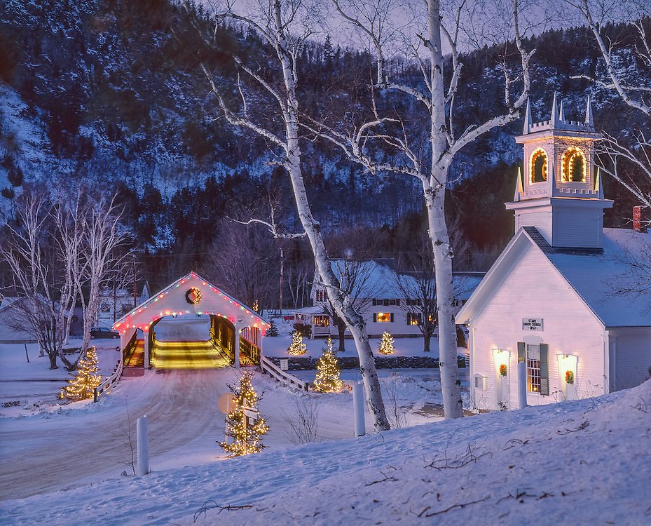 Stark Union Church, built 1853, and Stark Covered Bridge, lit up at night, with snow in winter, Stark, NH