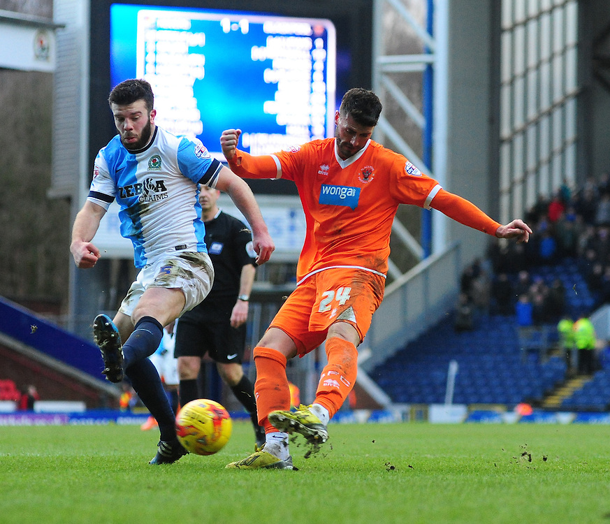 Blackpool's Gary Madine hits a shot at goal under pressure from Blackburn Rovers' Grant Hanley<br /> <br /> Photographer Chris Vaughan/CameraSport<br /> <br /> Football - The Football League Sky Bet Championship - Blackburn Rovers v Blackpool - Saturday 21st February 2015 - Ewood Park - Blackburn<br /> <br /> © CameraSport - 43 Linden Ave. Countesthorpe. Leicester. England. LE8 5PG - Tel: +44 (0) 116 277 4147 - admin@camerasport.com - www.camerasport.com