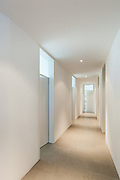 Interior of a modern house, corridor with many doors