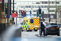 An ambulance near the Houses of Parliament, Westminster in central London, after a car crashed into security barriers outside the Houses of Parliament.