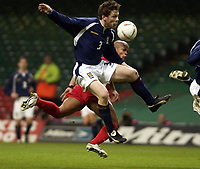 Picture: Henry Browne.<br /> Date: 18/02/2004.<br /> Wales v Scotland Friendly International.<br /> <br /> Robert Earnshaw heads in his second goal past Scotland's Gary Naysmith.