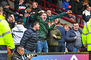 Bradford City fans celebrate Billy Clarke of Bradford City (17) scoring a goal to make the score 0-1 during the EFL Sky Bet League 1 match between Scunthorpe United and Bradford City at Glanford Park, Scunthorpe, England on 27 April 2019.