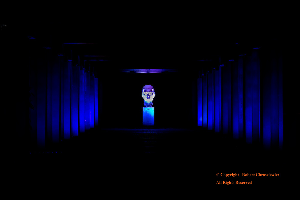 Blue to White: Just prior to the Radiant Run, a covered walkways symmetrical columns are coloured in blue light with a solitary Asiatic bust bathed in white, University of British Columbia, Vancouver, Vancouver British Columbia Canada.
