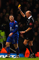 Photo: Daniel Hambury.<br />West Ham United v Manchester United. The Barclays Premiership. 27/11/2005.<br />Manchester's Wayne Rooney is booked.