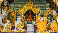 Buddha statues of the Shwedagon Pagoda at Yangon (Rangoon) in Myanmar (Burma)