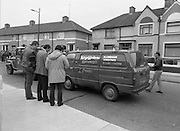 """John O'Grady Rescued By Gardai.   (R67)..1987..05.11.1987..11.05.1987..5th November 1987..After being kidnapped from his home in Cabinteely, Co Dublin, John O'Grady was finally rescued after twenty one days in captivity. he was located in a house inCarnlough Road, Cabra West, Dublin. During his ordeal Mr O""""Grady was mutilated by the kidnappers led by Dessie O'Hare to apply pressure on his family to pay the ransom sought. In an ensuing gun battle with the kidnappers a detective garda was shot and seriously wounded. In the chaos that followed the kidnappers escaped and were not all captured for a further three weeks after a massive manhunt...Picture shows a van which had been hijacked by the kidnappers being towed away by the Garda Technical squad for forensic examination."""