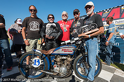 Brittney Olsen on her 1923 model J Harley-Davidson racer surrounded by her team after Billy Lane's Son's of Speed race during Daytona Bike Week. New Smyrna Beach, FL. USA. Saturday March 18, 2017. Photography ©2017 Michael Lichter