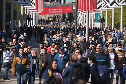 © Licensed to London News Pictures. 25/04/2021. London, UK. Up to 8,000 football fans arrive at Wembley Stadium to attend the Carabao Cup Final between Tottenham Hotspur and Manchester City. All attendees have to show evidence of a negative Covid-19 test to attend the event as part of the Events Research Programme (ERP) pilot scheme informing the government's decision on step 4 of its roadmap out of lockdown. Photo credit: London News Pictures