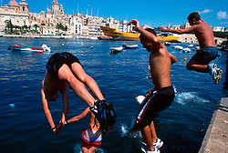 MALTA VALETTA JUL00 - Local boys jump into the water in the port of Marsa, Valetta.....jre/Photo by Jiri Rezac....© Jiri Rezac 2000....Tel:   +44 (0) 7050 110 417..Email: info@jirirezac.com..Web:   www.jirirezac.com