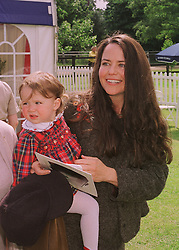 KOO STARK and her daughter TATIANA, at a polo match in Berkshire on 14th June 1998.MII 119