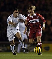Fotball<br /> Premier League England 2004/2005<br /> Foto: SBI/Digitalsport<br /> NORWAY ONLY<br /> <br /> Middlesbrough v Aston Villa<br /> Barclays Premiership, 18/12/2004.<br /> <br /> Middlesbrough's Boudewijn Zenden (R) takes on Aston Villa's Gavin McCann