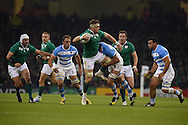 Jamie Heaslip of Ireland is tackled by Argentina's Guido Petti Pagadizaval. Rugby World Cup 2015 quarter-final match, Ireland v Argentina at the Millennium Stadium in Cardiff, South Wales  on Sunday 18th October 2015.<br /> pic by  Andrew Orchard, Andrew Orchard sports photography.
