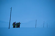UNIS students from nearby Longyearbyen hike together across Sverdruphamaren, Svalbard, past abandoned utility poles.<br /> <br /> Pictured: Alistair Everett, Mylène Jacquemart, Stephen Jennings, Marianne Andresen