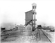 """D&RGW Durango coaling tower - looking north. #225 in on a roundhouse lead in the background.<br /> D&RGW  Durango, CO  Taken by Beam, George L. - ca. 1920-1929<br /> In book """"Durango: Always a Railroad Town (1st ed.)"""" page 19"""