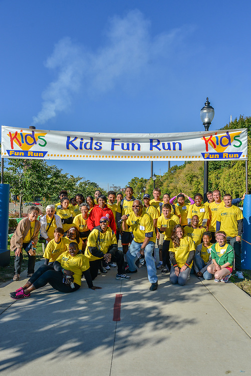 Volunteers at the finish line at the Kids Fun Run.