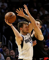 February 25, 2019 - Los Angeles, California, U.S - Dallas Mavericks' Luka Doncic (77) is defended by Los Angeles Clippers' Danilo Gallinari (8) during an NBA basketball game between Los Angeles Clippers and Dallas Mavericks Monday, Feb. 25, 2019, in Los Angeles. (Credit Image: © Ringo Chiu/ZUMA Wire)