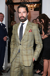 Image licensed to i-Images Picture Agency. 16/06/2014. Jack Guiness arriving for the launch of a Gregory Peck exhibition at  Huntsman tailors in Savile Row, London, to celebrate five decades of dressing the Hollywood actor. Picture by Stephen Lock / i-Images