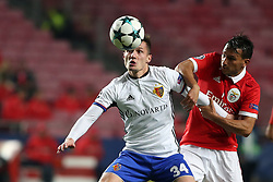 December 5, 2017 - Lisbon, Portugal - Basel's midfielder Taulant Xhaka from Albania (L) fights for the ball with Benfica's Portuguese midfielder Joao Carvalho during the UEFA Champions League Group A football match between SL Benfica and FC Basel at the Luz stadium in Lisbon, Portugal on December 5, 2017. (Credit Image: © Pedro Fiuza/NurPhoto via ZUMA Press)