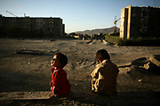 Children play in the incomplete apartment building in Macrorayon which stopped its construction during the Soviet rule, Kabul, Afghanistan, Tuesday, June 19, 2007. 13 families from Shomali Plain moved here since the Taliban time around 1999. In 2006, the main group of refugees under UNHCR's mandate continued to be Afghans (2.1 million), followed by Iraqis (1.5 million), Sudanese (686,000), Somalis (460,000), and refugees from the Democratic Republic of the Congo and Burundi (about 400,000 each).  In addition to refugees, for a number of years UNHCR has also been helping specific populations of internally displaced people (IDPs). These are people who have also fled their homes because of threats to their safety but who have not crossed any internationally recognised borders. At the end of 2006, the total number of conflict-related IDPs worldwide was estimated at 24.5 million by the Norwegian Refugee Council's Internal Displacement Monitoring Centre.