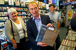© Licensed to London News Pictures. 29/07/2015. Surrey, UK. Newly elected Liberal Democrat leader Tim Farron visits Banquet Records in Kingston upon Thames and meets two new Liberal Democrat councillors Jon Tolley and Geraldine Locke who have each won by-elections since the General Election on Wednesday, July 29, 2015. Photo credit: Tolga Akmen/LNP