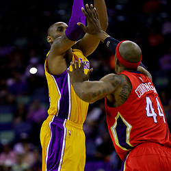 Apr 8, 2016; New Orleans, LA, USA; Los Angeles Lakers forward Kobe Bryant (24) shoots over New Orleans Pelicans forward Dante Cunningham (44) during the first quarter of a game at the Smoothie King Center. Mandatory Credit: Derick E. Hingle-USA TODAY Sports