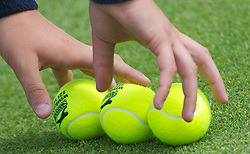 LONDON, ENGLAND - Thursday, June 23, 2011: Tennis balls during the Gentlemen's Doubles 1st Round match on day four of the Wimbledon Lawn Tennis Championships at the All England Lawn Tennis and Croquet Club. (Pic by David Rawcliffe/Propaganda)