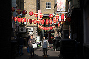 Street scene with red Chinese lanterns for Chinese New Year celebrations in Chinatown in London, England, United Kingdom.