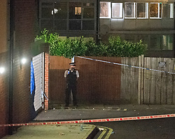 © Licensed to London News Pictures. 11/07/2019.<br /> Greenwich,UK A police officer standing near a garage area. A young man in his early 20s has been stabbed to death in Greenwich, South East London, Met police were called to the Shooters Hill area. A cordon is in place with police on guard. Photo credit: Grant Falvey/LNP