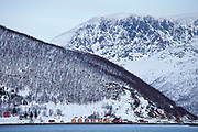 Homes and fishing huts in hamlet on Kvaloya Island near Lauklines in the Arctic Circle, Northern Norway<br /> FINE ART PHOTOGRAPHY by Tim Graham