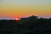 Silhouette of an Israeli tank at sunset