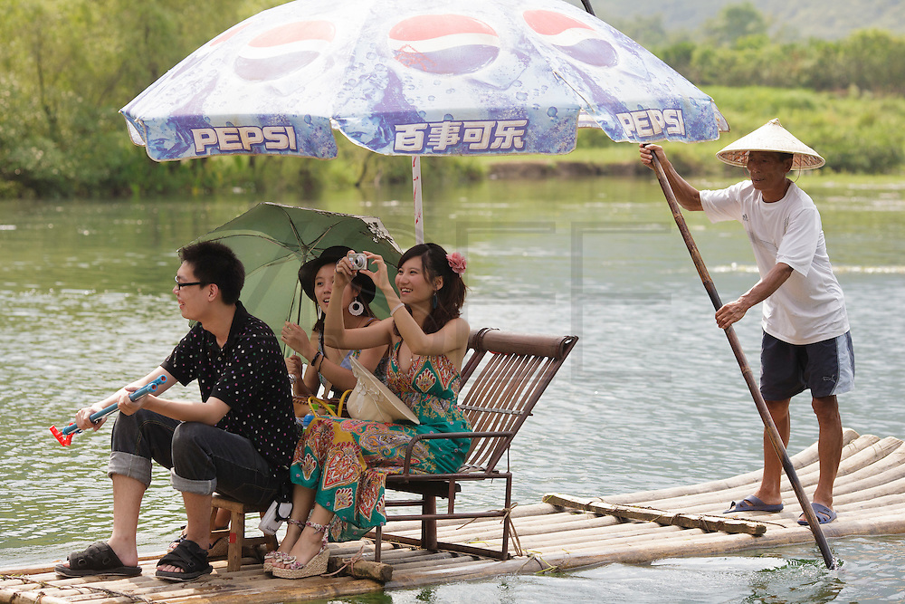 Tourists rafting in a river in Yangshuo, near Guilin.