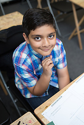 © Licensed to London News Pictures . 19/08/2015 . Oldham , UK . SAMI AKBAR (11) (correct) from Ashton , took and passed his GCSE maths at the age of ten . He achieved a B in two Higher Maths papers . Photo credit : Joel Goodman/LNP