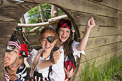 children playing on a pirate ship in adventure playground, Bavaria, Germany