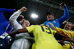 Colombia's Yerry Mina hugs fans in the crowd as he celebrates scoring his side's first goal of the game during the FIFA World Cup 2018, round of 16 match at the Spartak Stadium, Moscow.