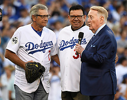 October 25, 2017 - Los Angeles, California, U.S. - Former Los Angeles Dodgers greats Steve Yeager, left, with Fernando Valenzuela and Hall of Fame announcer Vin Scully prior to game two of a World Series baseball game against the Houston Astros at Dodger Stadium on Wednesday, Oct. 25, 2017 in Los Angeles. (Photo by Keith Birmingham, Pasadena Star-News/SCNG) (Credit Image: © San Gabriel Valley Tribune via ZUMA Wire)