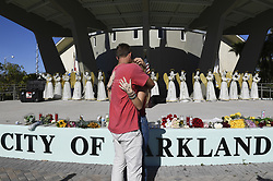 Zack King, left, comforts friend Mychal Bradley in front of 17 angels representing those who died in Wednesday's mass shooting at Marjory Stoneman Douglas High School in Parkland, FL, USA, on Thursday, February 15, 2018. Photo by Taimy Alvarez/Sun Sentinel/TNS/ABACAPRESS.COM