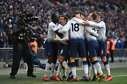 Tottenham Hotspur's Son Heung-min is mobbed by team mates as they celebrate him scoring their first goal