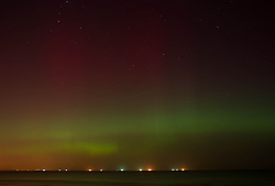 © Licensed to London News Pictures. 27/02/2014<br /> <br /> Saltburn, England<br /> <br /> The Aurora Borealis is visible over Saltburn by the Sea in Cleveland.<br /> <br /> Photo credit : Ian Forsyth/LNP