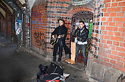 Germany, Berlin, two buskers playing on the Oberbaum Bridge