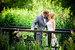 Bride and Groom having a romantic kiss in the beautiful grounds of Knebworth House