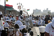 12 June 2010- Coney Island, Brooklyn, NY- Crowds at the 20th Annual Tribute to Our Ancestors of the Middle Passage, which was intially celebration of the lives of African Slaves who were either killed or thrown overboard Slave Ships bound for the Americas to either lessen the load and or cut back for food rations. The Middle Passage refers to passge way which Slave Ships travelled with their ' human cargo.' A great majority of enslaved Africans, chose death and leaped from ships to either swim hopefully back to the continent of Africa or give their lives for the sake of freedom. It is esitimated that 100 million souls were lost during the duration of the Middle Passage which lasted from 1619 to the 1830's.